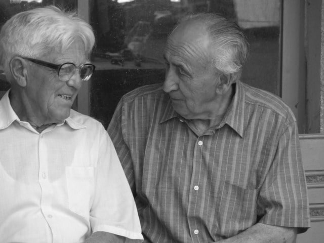 Image of two elderly people for an article about national healthy aging month.