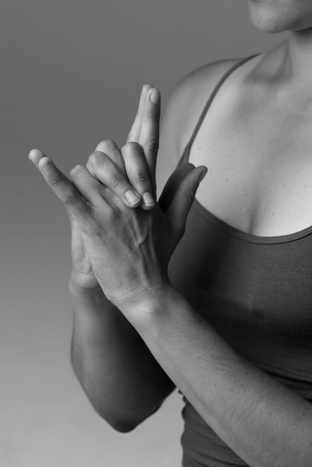 Image of a woman's hands during yoga for an article about wheelchair yoga for seniors.