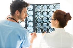 Doctors Looking At MRI Scan Of The Brain