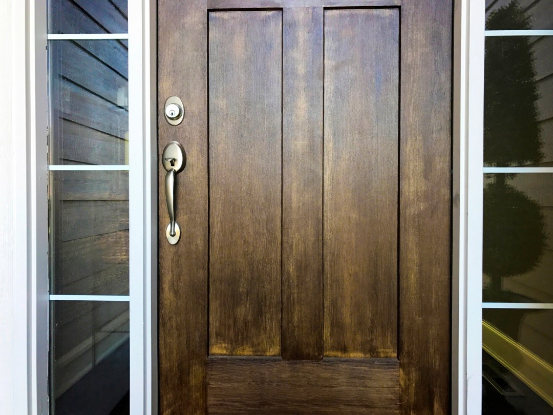 Wooden door with brass lock and handle