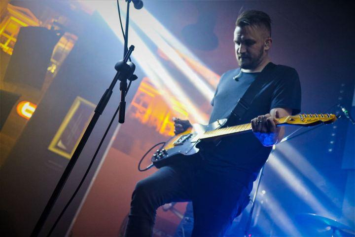 CJ playing guitar for Ranges in Lyon