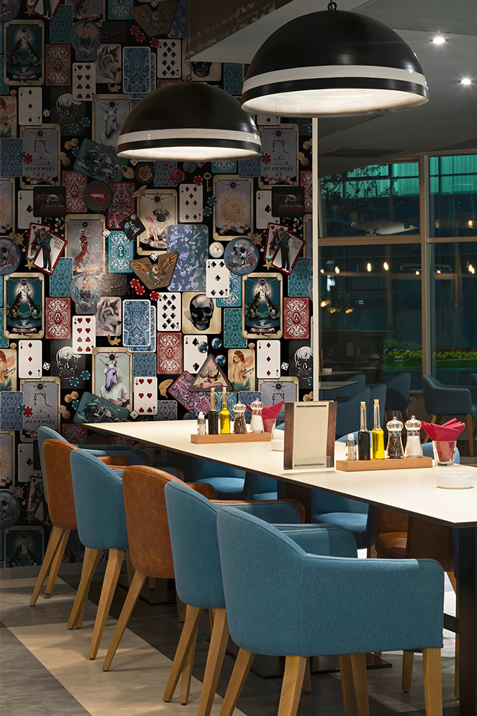 This is a Funky and quirky commercial vinyl wallpaper design from australia. It is shown here in a restaurant, bra with matching blue and leather seats.