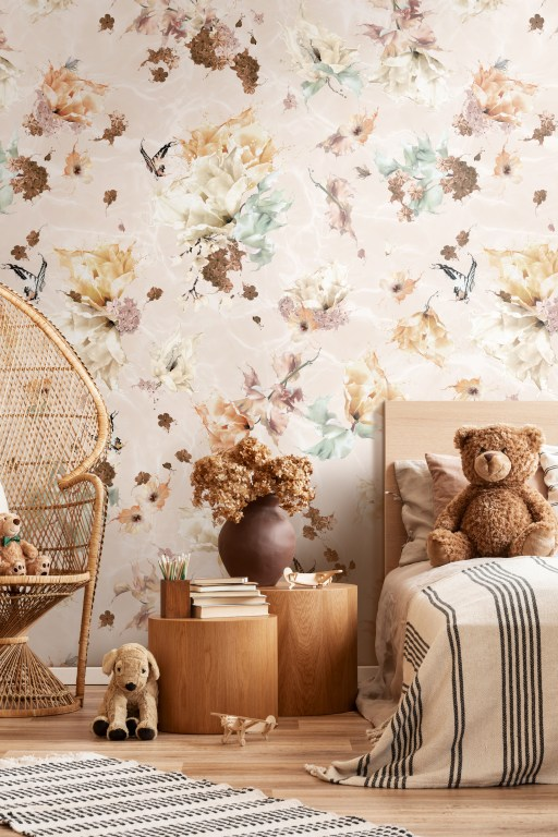 Submerse - Dusty Rose boho wallpaper. Features a floral and butterfly design for interior walls with a surrealist twist! In colours of earth tones of taupe, copper, rust, cream, pink, browns and rustic colours tone with sage green. Featured here in a kids childrens bedroom with rattan furniture.