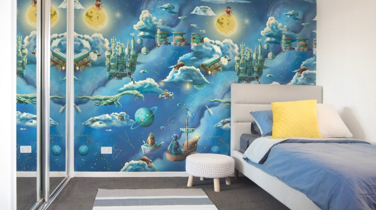 Space and Galaxy Kids Interior Wallpaper Design - featuring a grey blue and white bedroom with custom kids wallpaper. Wallpaper features the moon, night sky, clouds, pirate ships, flying trains, dragon, galaxy and more.