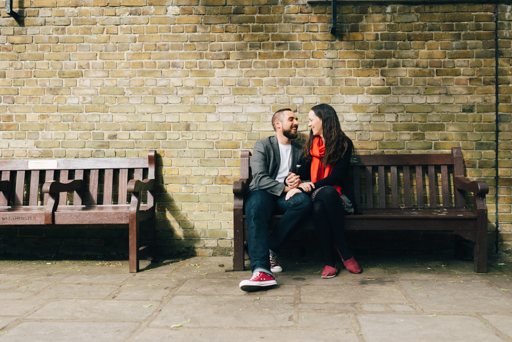 london engagement shoot couple on park bench together