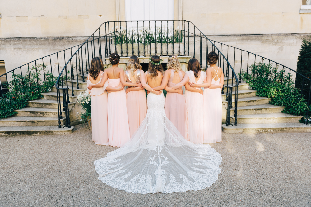 Bride and bridesmaids with dress train