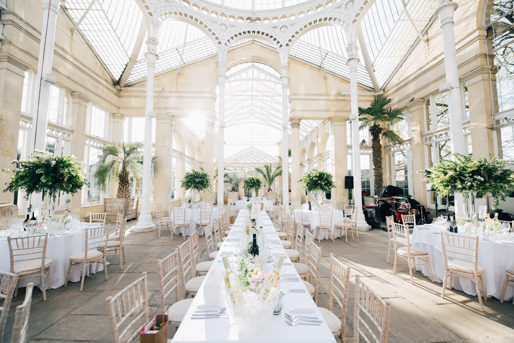 Photo of Syon Park conservatory in the sunshine with tables laid