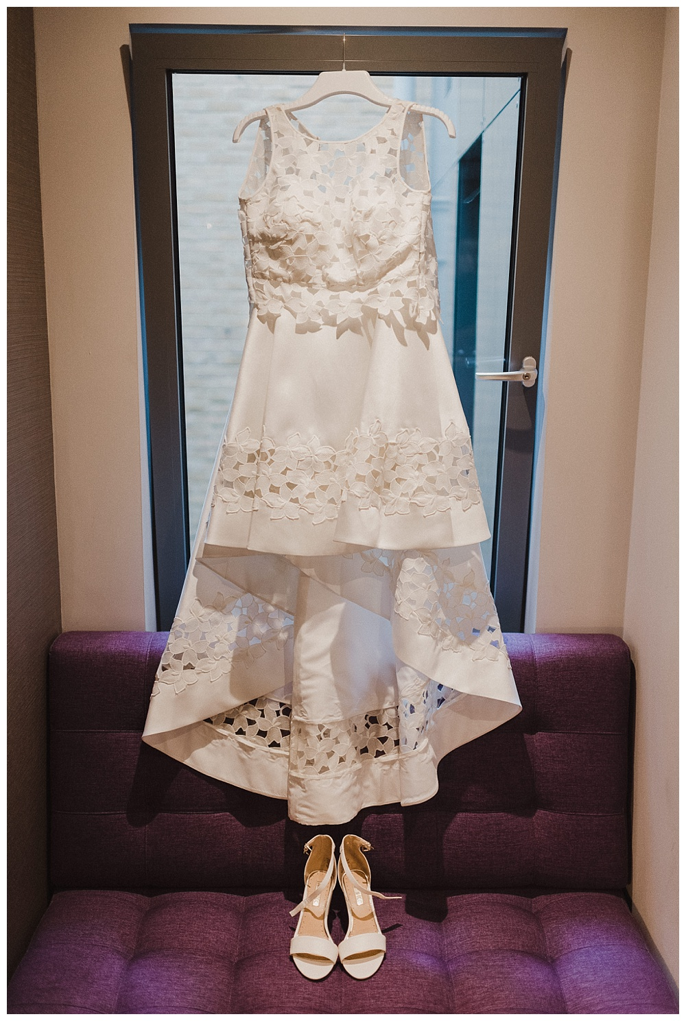 Bride's wedding dress in her room at the courthouse hotel