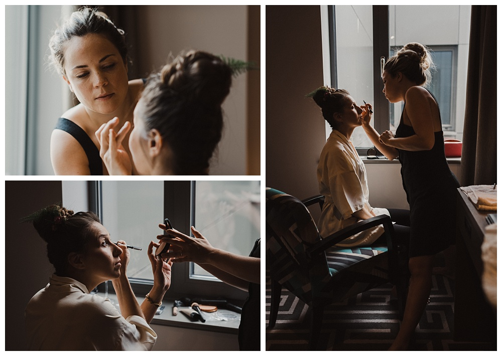 Bride gets ready and has her makeup done by a friend at the courthouse hotel