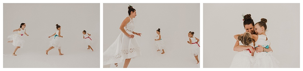 Bride chased by flower girls in photo studio