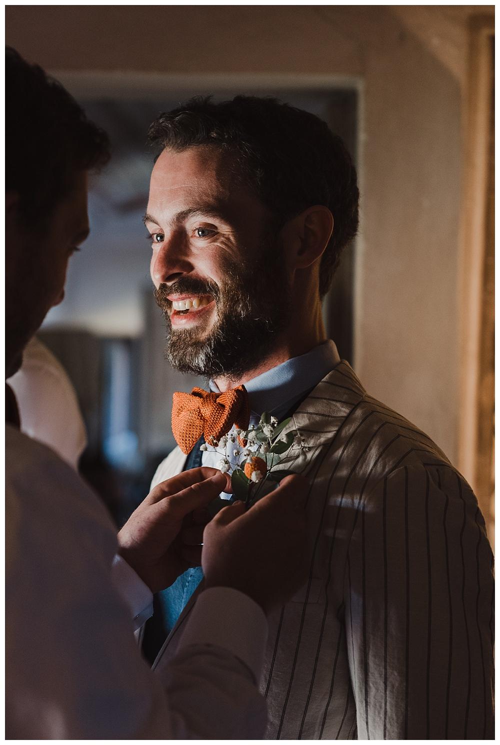 Groom smiles before wedding