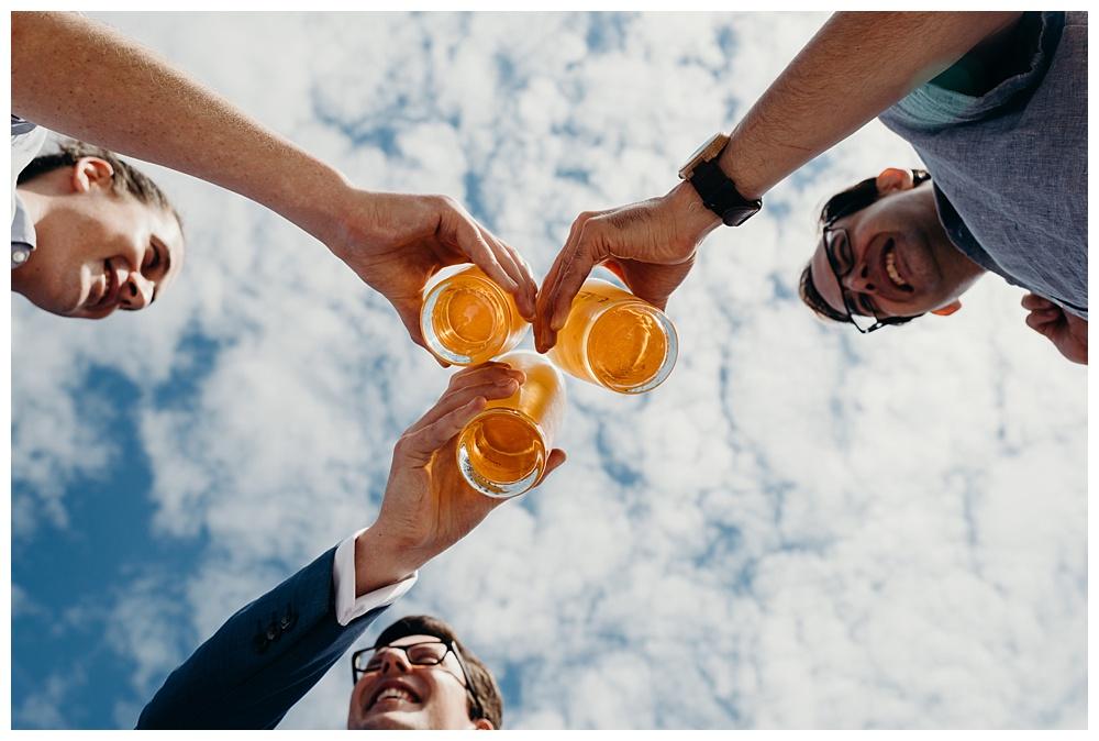 Bavarian wedding groomsmen drink beer