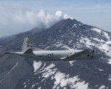 """030526-N-3122S-005 Naval Air Station (NAS) Sigonella, Sicily (May 26, 2003) -- A P-3C Orion aircraft assigned to the """"Tigers"""" of Patrol Squadron Eight (VP-8) flies over Mt. Etna. VP-8 is home-based in Brunswick, Maine, and is currently deployed to Naval Air Station (NAS) Sigonella providing logistical support for Commander, U.S. Sixth Fleet and NATO forces in the Mediterranean Sea. U.S. Navy photo by Photographer's Mate Airman Shannon R. Smith. (RELEASED)"""