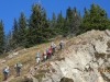 The group going up a steep  section passed the col