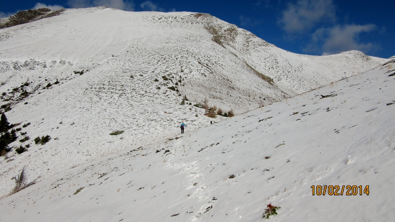 Cutting across to the Col of Numa Peak.Peak is top right