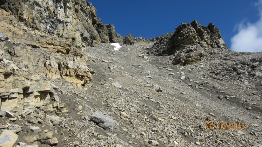 Heading up the scree to the snow patch