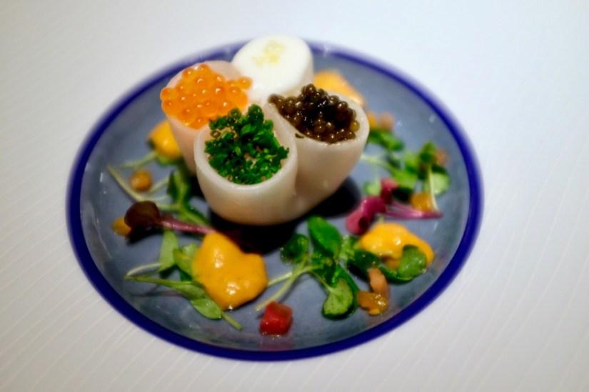 Four Seas Dumpling - russian golden osetra, sea urchin, heirloom salad