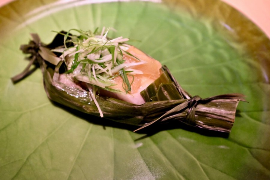 Black cod wrapped in banana leaf, pickled white melon, bamboo 'cannelloni'