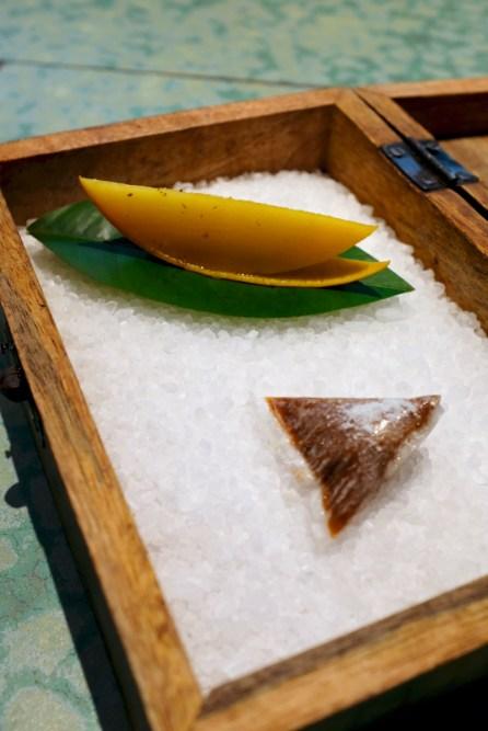 Disfrutar - Savory wanut candy with mango, tonka bean, whisky