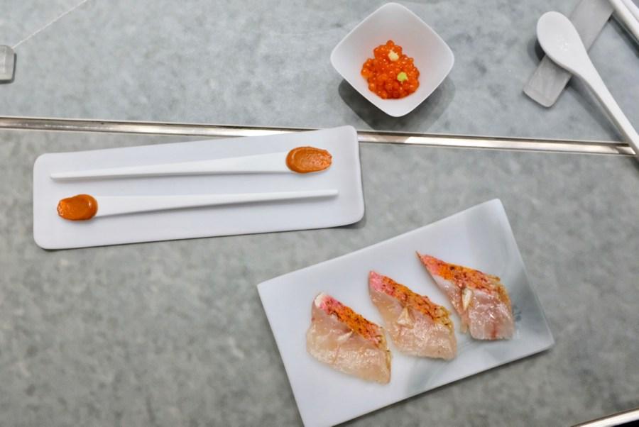 Enigma Concept - Mullet paté lollipop. Cured red mullet, mullet head oil, fried scales. Ikura roe.