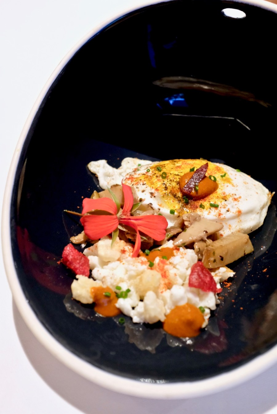"Arzak - Egg with freeze dried tomato candy, ""pozole"" corn, porcini, white mushroms"