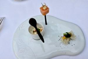 Epicure - Amuse bouche - Pea, popcorn, cream. Salmon, turnip. Curry chip, fish.