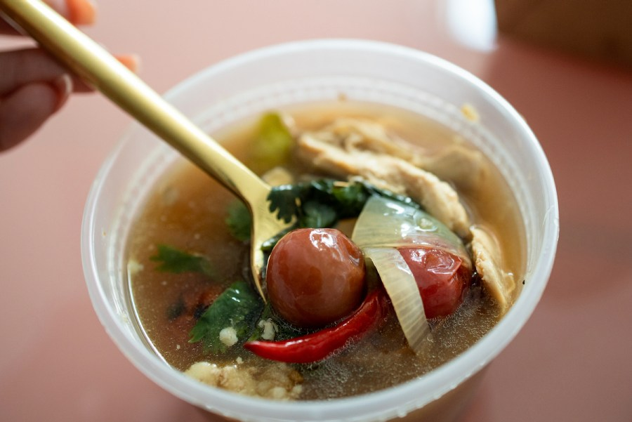 Nari Takeout - Tom Khlong - Spicy chicken soup with aromatic smoked fish broth, herbs, blistered tomatoes, tamarind