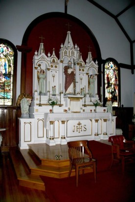 Made locally in wood the high altar reflects the Gothic style that was popular on the Island in earlier times.