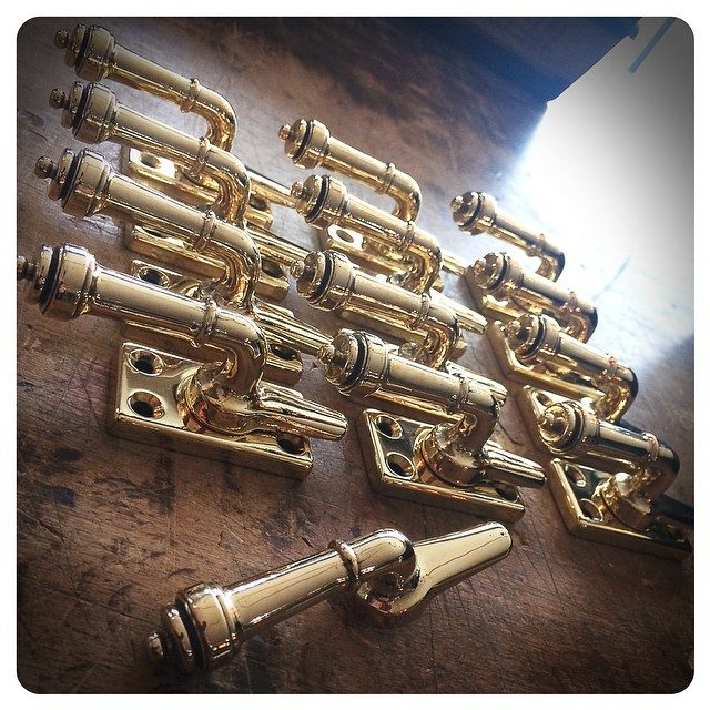 custom lever casement latches | polished brass
