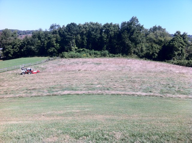 Mowing the native area behind 11 North.