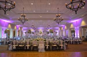Lavender event uplighting dramatically changes the room and adds a great touch