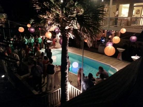 ocean isle beach house wedding reception lighting pool globes lanterns