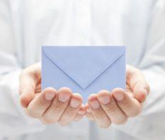 Blue paper envelope in hands