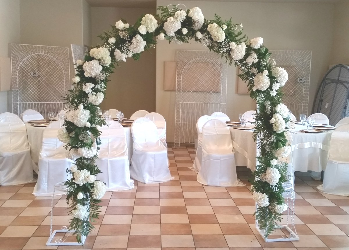 white and cream wedding arch wilsons floral design