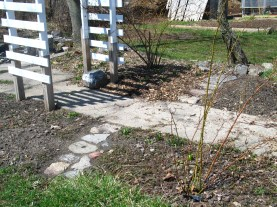 Keturah has worked hard on her flower bed and stone path