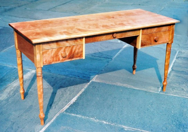 Shaker style writing desk with turned legs and dovetailed drawers. 58W