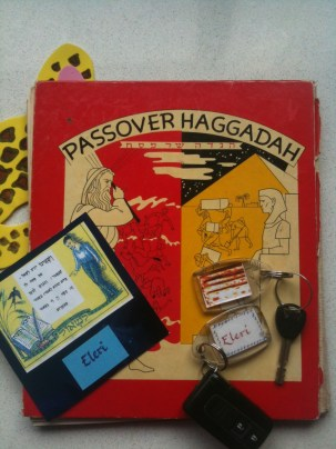 Family Haggadah and key rings made from the place names from a Seder