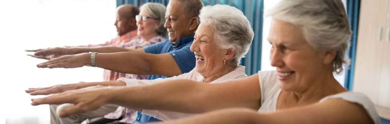 A group of seniors enjoying a fitness class at Winchester Glen in Oshawa which offers assisted living suites.