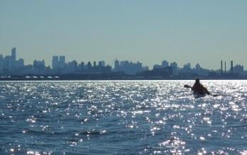The Manhattan skyline glitters ahead