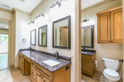 Granite is featured throughout the bathrooms.