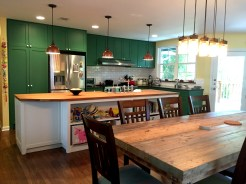 Another view of the kitchen and dining areas.
