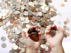 Saving money coins-in-hand- by Claudio Jule FI