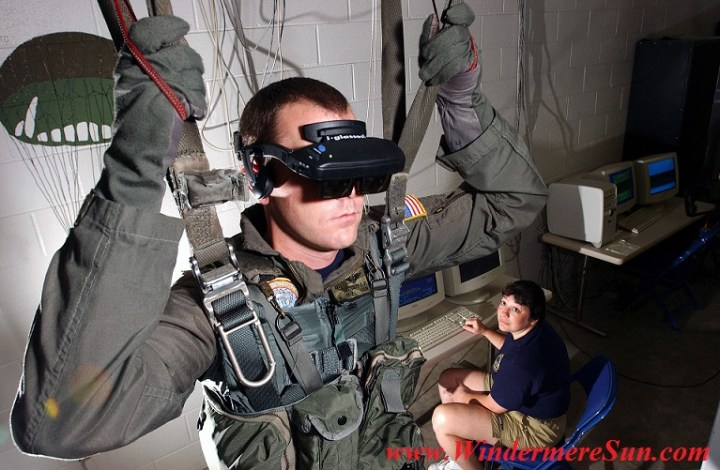 VR-Helm U.S. Navy personnel using a VR parachute training simulator