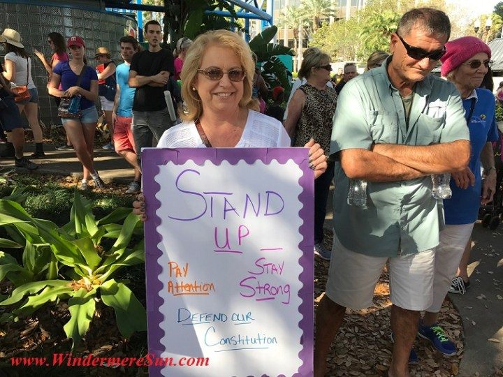 Woman with Stand Up sign final