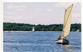 Custom wooden drag boat out for a sale on Lake Champlain