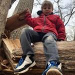 Boy on a log
