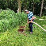 Man pumping septic system