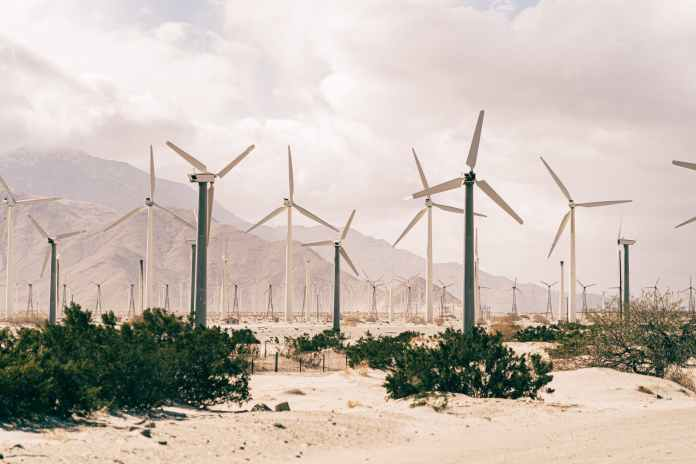 wind turbines on brown sand