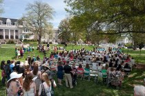 Alumnae, family and friends gather on the front lawn in front of the May Court during the May Day celebration of Alumnae Reunion Weekend.