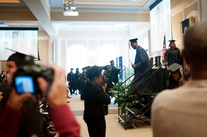 Christopher Carpenter leaves the stage after receiving his Bachelor of Business Administration.